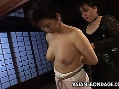 Mature bi-atch gets tied up and hung in a bdsm session