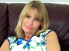 British gilf Sapphire Louise pleases her pussy with a fuck stick