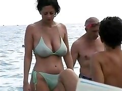 dates25com Hot cougar in swimsuit at the beach