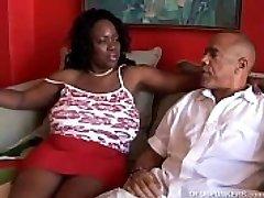 Busty mature black BBW enjoys to suck cock