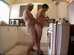 Aged couple having joy in the kitchen