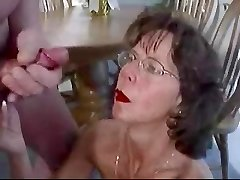 Mature brunette in glasses nourishes huge facial cumshot cumshot.