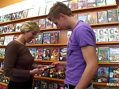 Handsome blonde mature bangs him in the video store