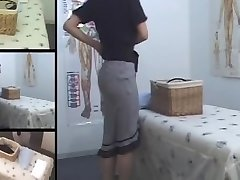 Cute Jap MILF fingered in hidden cam massage room vid