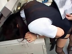 Jap girl romps in the office with head in the photocopier