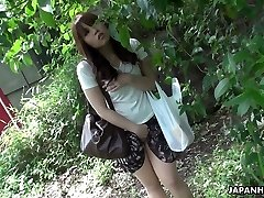 Beautiful and curious sandy-haired Asian teen observes sex on the street and masturbates
