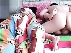 Asian husband cheating on wifey while she is sleeping.