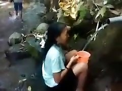 Indonesia lady outdoor nature douche