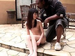 Tiny Japanese doll gags on big dark-hued cock outdoors
