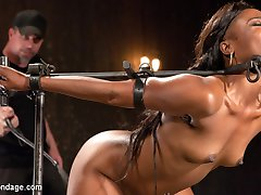 Chanell starts in an inverted ankle suspension. Her body is attacked with a flogger to soften up...