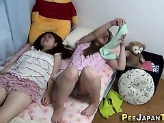 Asian slut rubs herself
