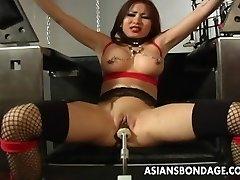 Big-boobed brunette getting her wet snatch machine fucked