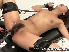 Tied Japanese handles sex machines like a trooper