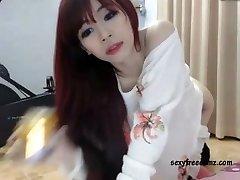 Super-cute Asian Redhead Masturbating Solo