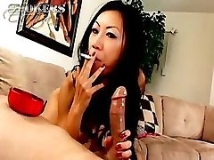 Tia Ling likes to deepthroat on a cigarette and a hard cock at once