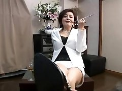 chinese sole femdom smoking with cigarette holder