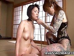 Tattooed up Japanese domina strap on fucking the victim