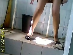 Hidden piss web cam shoots Asian in pantyhose peeing in toilet