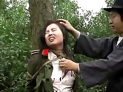 Chinese army girl trussed to tree 1