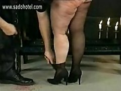 German master bashes dirty large slave in his dungeon on her large ass with a whip