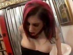 Redhead punk chick fucks girlfriends ass