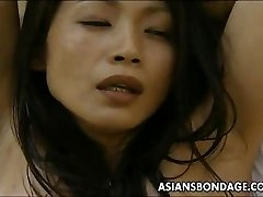 Japanese bitch trussed up so the man can fuck her