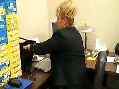 tall mature chick in office with  her foot slave