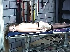 Submissive slut gets body trussed with cord and pulled by dom