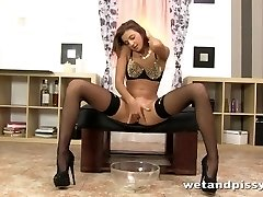 Super super-hot brunette peeing in a cup