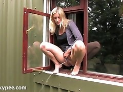 Desperate Blond Urinating Out of Office Window