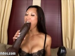 Busty japanese rides a massive brown brutal dildo