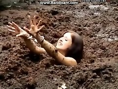 Cuffed dame gets stuck in deep mud