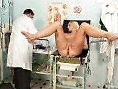 Vagina exam of an attractive stunning platinum-blonde