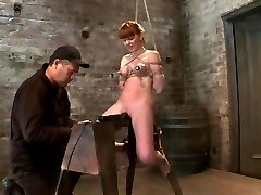 Uber-sexy red head with Ample lactating nipples severely bound in a reverse prayerMade to spunk!