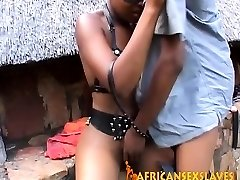 Smoothly-shaven African in leather bound and torn up