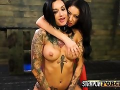 Tatted lesbian pleased with toys