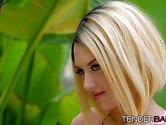 Kinky blonde babe with tattoos Emma Mae jacks outdoors