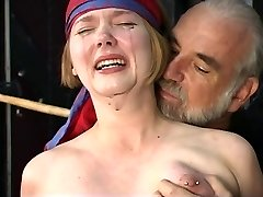 Cute young blonde with puffy tits is restrained for nipple clip play