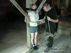 Tied to a pole blond gets her bald pussy punished