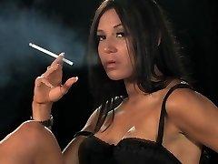 Smoking dark-haired posing