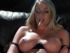 Smoking blonde in lingerie + toying