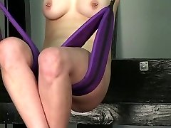 Ultra-cute tattooed youthful blonde has her pussy tortured while she rides sex swing