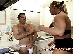 Angry dominatrix with immense muscles hurts her husband