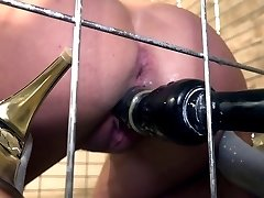 Lola Wan helpless in a cage trussed gagged dildoed and vibrated