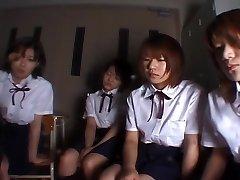 Four Japanese school girls slobbering on tutor