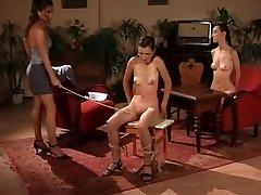 Kinky fucksluts enjoying BDSM flagellating and spanking