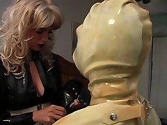 Maid slut positioned in latex