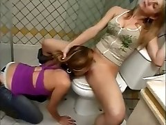 Slave licking pussy in the rest room