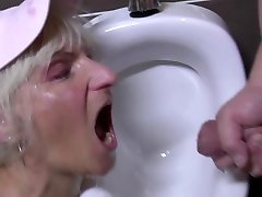 Crazy mature twat drinks pee in male s rest room