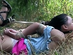 Asian teenie strapped and gagged made to orgasm!